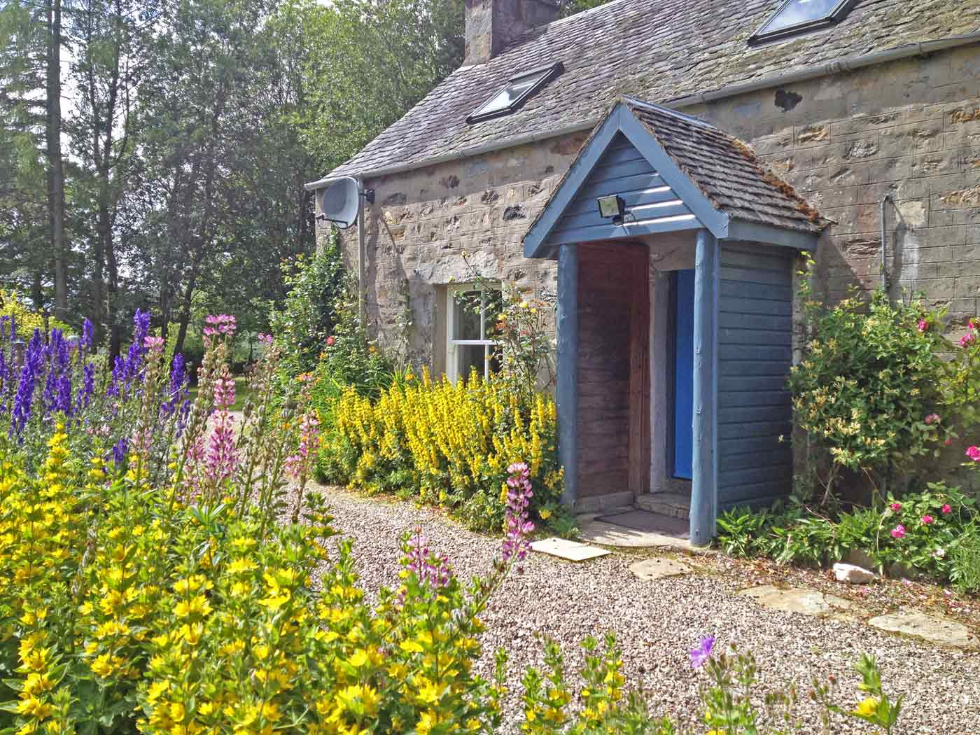 Rose Cottage with flowers